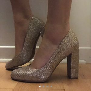 Gold sparkly high heels